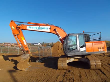 Side view of Digger working on housing estate